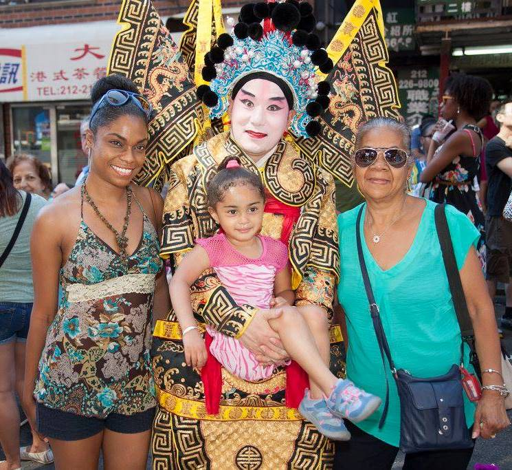 Peking Opera performer with audience members at our Egg Rolls, Egg Creams, & Empanadas Festival